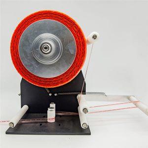 Stroj na držanie pásky